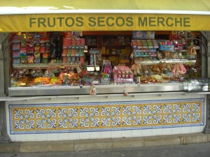 A stand outside the Cental market that specializes in a variety of nuts.