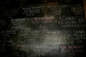 One of the many wine lists that occupy the walls