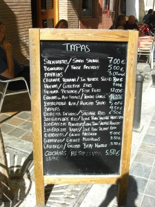 The menu board at Aries