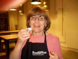 Susan having food and fun.